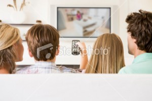 stock-photo-8375542-family-in-living-room-watching-tv